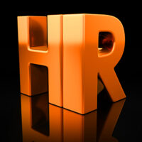 HR letters on black background with reflection. Human resources or recruitment golden acronym