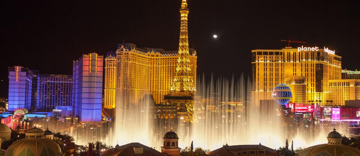 USA. LAS VEGAS - FEB 14 2009: Night view of the dancing fountains of Bellagio and the Eiffel Tower replica of Paris Las Vegas Resort in Las Vegas Nevada, USA