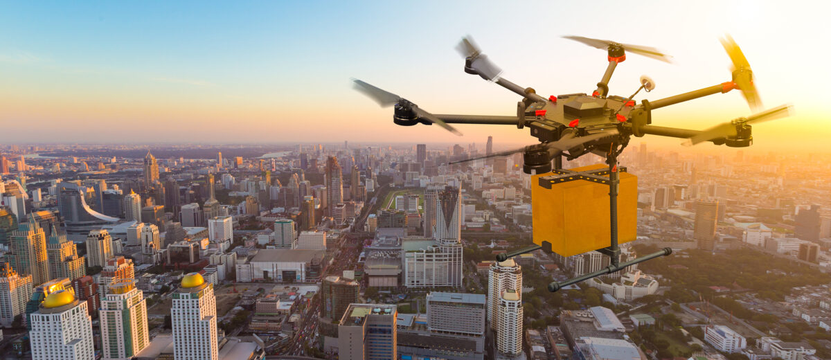 Drone transport  flying with cardboard box above city, futuristi