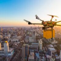 Drone transport  flying with cardboard box above city, futuristi